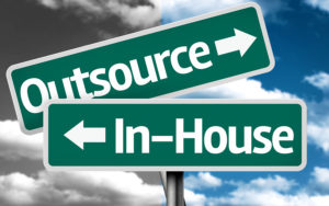 Outsource x In-house creative sign with clouds as the background